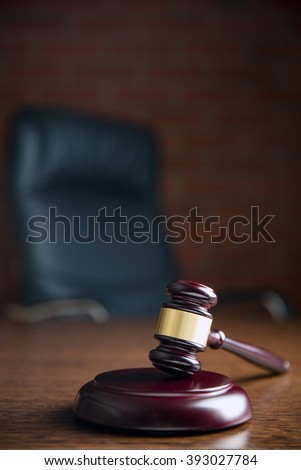 the judge gavel on wooden table - stock photo