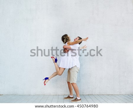 The jumping bride and the happy groom. Wedding day. - stock photo