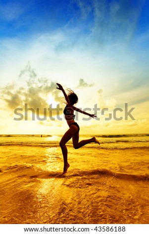The jumping girl on a tropical beach