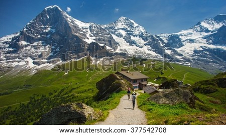 The Jungfrau, Eiger and Monch one of the main summits of the Bernese Alps and one of the most distinctive sights of the Swiss Alps.