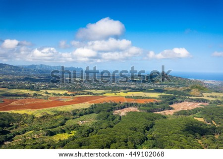 The Kalepa Ridge and Moloaa Forest Reserve dominate the otherwise flat plains - stock photo