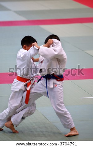 The karate kids fighting for the competition - stock photo