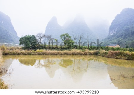 The karst mountains and rural scenery in winter
