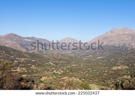 The Kedros Mountain on Crete. On the old road to Rethymnon. Landscape, Mountain and Olive Groves in south Crete. On the left side in the mountains the village Melambes