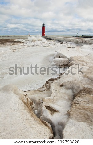 The Kenosha Pierhead light is surround by winter ice, Kenosha, Kenosha County, Wisconsin - stock photo