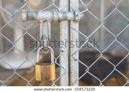 The key to lock the cage dog. - stock photo
