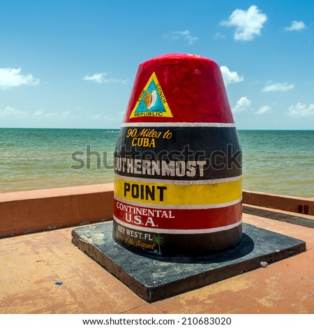 The Key West, Florida Buoy sign marking the southernmost point on the continental USA and distance to Cuba. - stock photo
