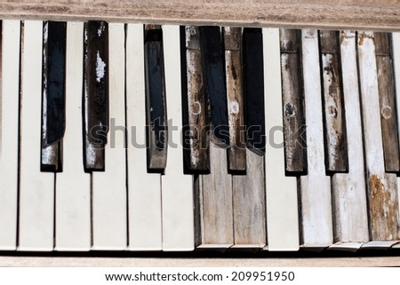 The keys of a piano left to the weather and sun in the Nevada desert - stock photo