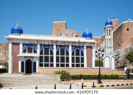 The Khor Mosque in Muscat, The Sultanate of Oman, with the medieval Fort Al-Mirani in the background. - stock photo