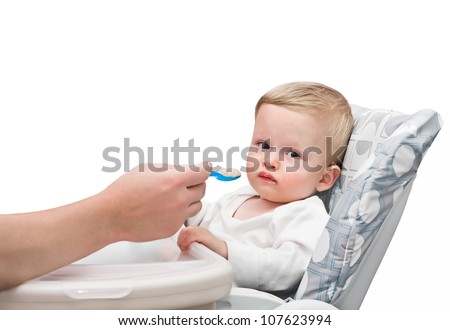the kid doesn't want to eat porridge - stock photo