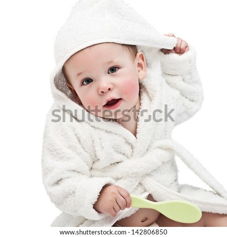 the kid in a bathrobe on a white background - stock photo
