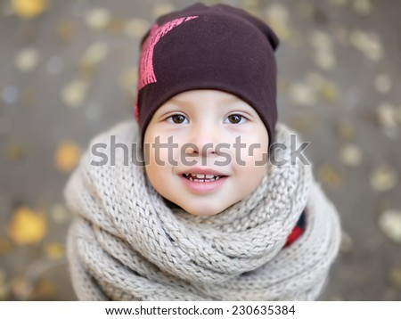the kid is dressed in warm clothes - stock photo