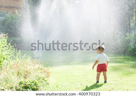 the kid looks at the fountain in the glade