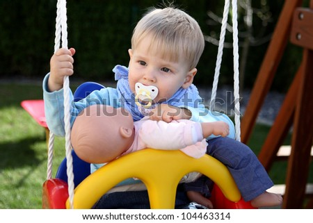 The  kid on the swing - stock photo