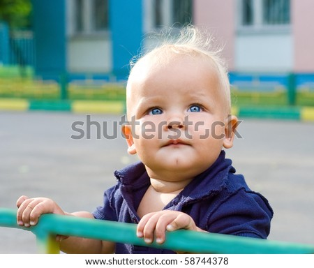 The kid with blue eyes on a children's playground