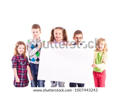 The kids are holding a white blank