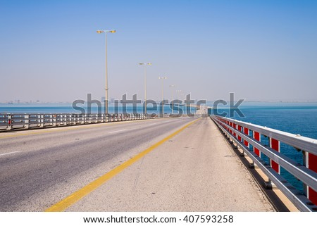 The King Fahd Causeway toll road bridge in the Arabian Gulf between Saudi Arabia and Bahrain looking towards Al Khobar, Saudi Arabia from the highest point on the bridge. - stock photo
