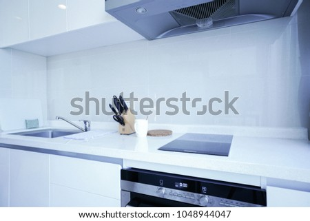 The kitchen is white with a floor window.