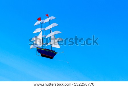 The kite shape of Brig on the blue sky background. - stock photo
