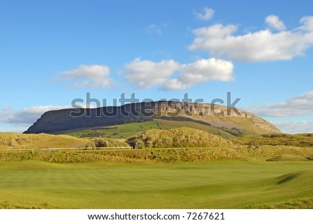 The Knocknarea mountain rising above Strandhill in County Sligo, West Ireland - stock photo