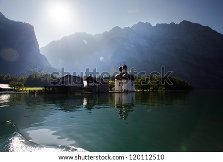 The Koenigssee near Berchtesgaden, Bavaria, with the Church of St. Bartholomae on a sunny day in summer - stock photo