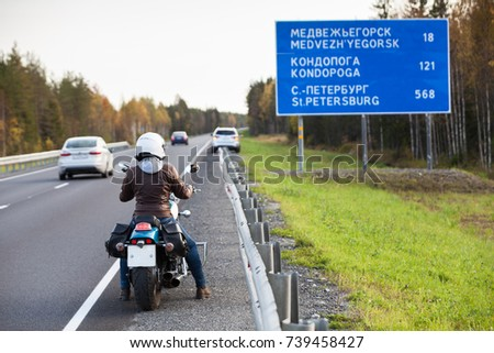 The Kola northern highway with information board with distances to Karelian cities. Karelia, Russia