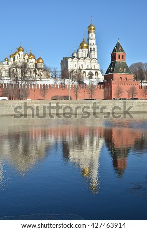 The Kremlin cathedrals and the Ivan the Great bell tower. Moscow Kremlin clear December day. - stock photo