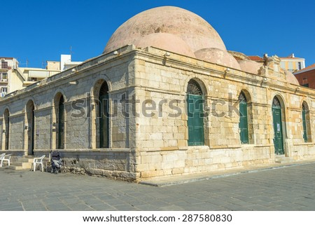 The Kucuk Hasan Pasha mosque in the harbor of Chania, Crete, Greece - stock photo