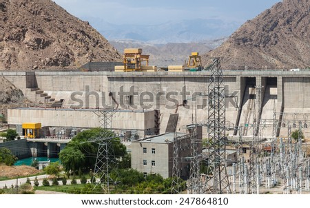 The Kurpsai Dam on the Naryn River in Kyrgyzstan - stock photo