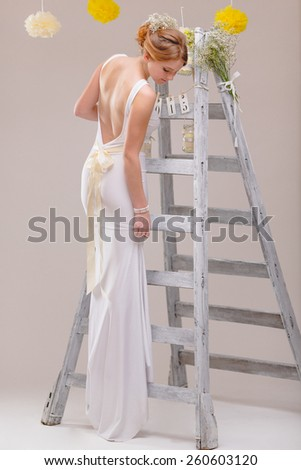 The Ladder / Studio shoot from a young Bride, some fine film noise effect added - stock photo