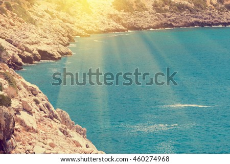 The lagoon with rocky cliffs with sunlight