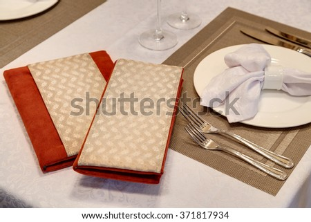 the laid table with the menu and the account at restaurant in classical style - stock photo