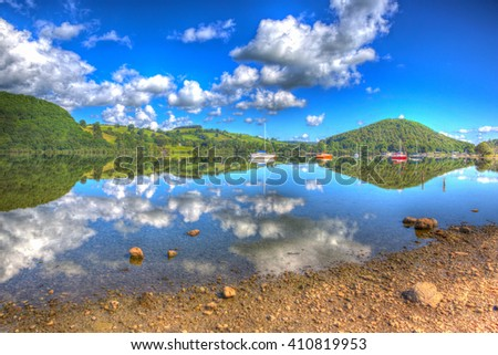 The Lake District England UK at Ullswater with mountains and blue sky on beautiful summer day with reflections in HDR