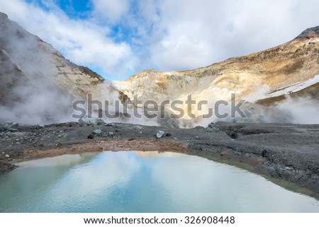 The lake in the crater of the volcano. Kamchatka Peninsula. Pacific Ocean. Russia. - stock photo