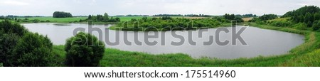 The lake in the green nature. Anyksciai. Lithuania. - stock photo