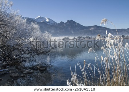 The Lake Kochel is on the edge of the Bavarian Alps at the foot of the popular hiking mountains Herzogsstand - stock photo