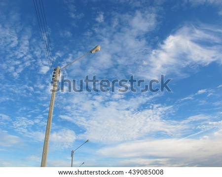 the Lamp post and blue sky.Blue sky on the afternoon of the day. A fluffy white clouds and bright atmosphere. - stock photo