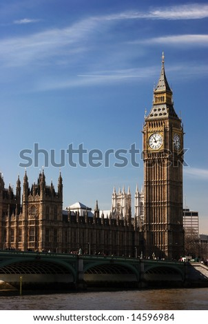 The landmark of London the Parliament and the Westminster bridge with blue sky - stock photo