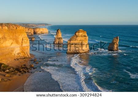 The landmark Twelve Apostles sea stacks at sunset, along the famous Great Ocean Road in Victoria, Australia - stock photo