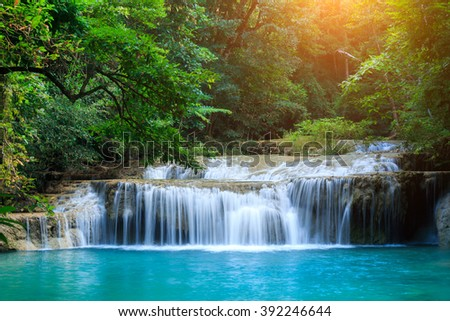 The landscape photo, beautiful waterfall in rainforest, Erawan National Park in Kanchanaburi, Thailand - stock photo