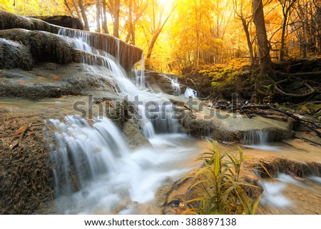 The landscape photo, Huay Mae Kamin Waterfall, beautiful waterfall in autumn forest, Kanchanaburi province, Thailand - stock photo