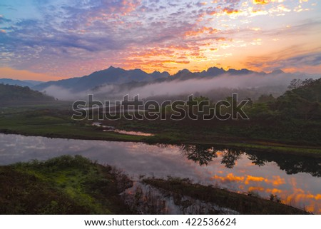 The landscape picture of river, trees, mountains and sea fog from the view point during morning time.  - stock photo