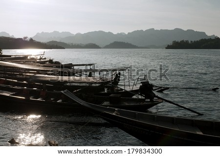 The landscape with boats and a lake. Chiew Lan Lake (Rajjaphapa Dam), Thailand