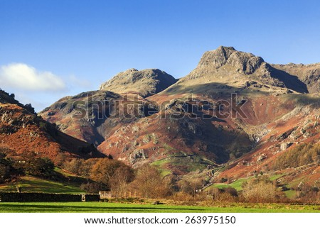 The Langdale Pikes on a sunny Autumn day. A lovely view of the magnificent Langdale Pikes on a glorious Autumn day. - stock photo