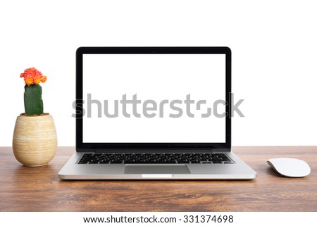 The laptop on the table with the mouse