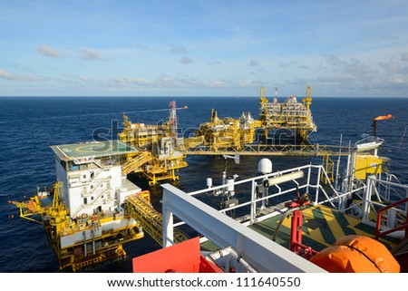 The  large offshore oil rig drilling platform is in the gulf of Thailand.