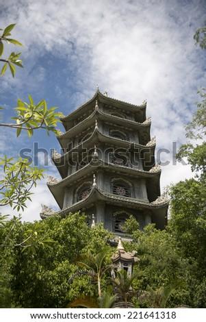 The large pagoda atop Marble Mountain in Da Nang, Vietnam - stock photo
