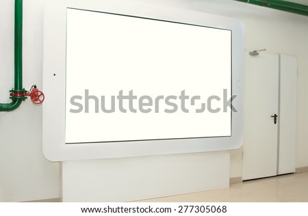 The large touchpad on the wall for display advertising - stock photo
