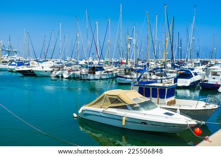 The Larnaca Marina is full of white yachts, always ready for the trips along the coast, Cyprus. - stock photo