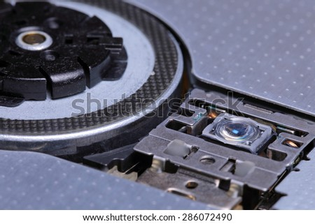 The laser and the drive device Compact Disc, close-up - stock photo